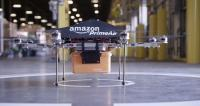 A flying mini-drone that would be used to fly small packages to consumers at the Amazon Prime Air Fulfillment Center in near Cambridge. Picture: AFP/Amazon Source:AFP