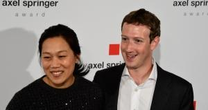 Facebook founder and CEO Mark Zuckerberg (R) and his wife Priscilla Chan. John MACDOUGALL / AFP