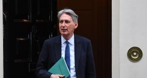 British Chancellor of the Exchequer Philip Hammond, enroute to deliver his Autumn Statement before Parliament, on November 23, 2016. Britain today delivers a first budget since the Brexit referendum, with government hopes of trimming austerity hampered by financial uncertainty surrounding the country's EU exit strategy. BEN STANSALL / AFP