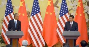 US President Barack Obama (L) and China's President Xi Jinping (R)
