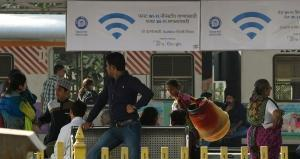 Advertisements for a new free Wi-Fi Internet service hang in Mumbai's central railway station on January 22, 2016. Indian Railways' RailTel has announced the launch of free high-speed public Wi-Fi service, in partnership with Google, with plans to introduce the service to some 100 of the country's busiest stations by the end of 2016. AFP PHOTO / PUNIT PARANJPE